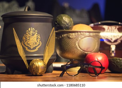 EDINBURGH, SCOTLAND - May 13, 2018: Display of Harry Potter related objects : glasses, quidditch ball and pot.