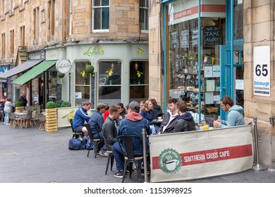 Edinburgh, Scotland - May 20, 2018: People sitting at terrace of cafe near Waverley train station
