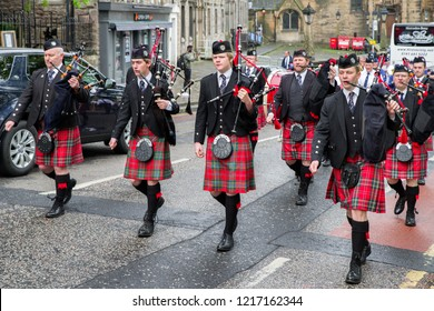 EDINBURGH, SCOTLAND - MAY 20: Ceremonial march of orchestra with bagpipes and kilts on  May 20, 2018 in Edinburgh