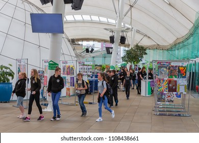 Edinburgh, Scotland - May 24, 2018: Group of students visiting science museum Dynamic Earth. The entrance is decorated with drawings of school children.