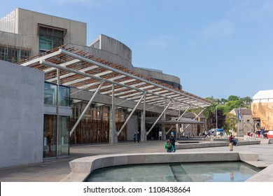 Edinburgh, Scotland - May 24, 2018: Square with pond in front of Scottish Parliament building in Edinburgh.