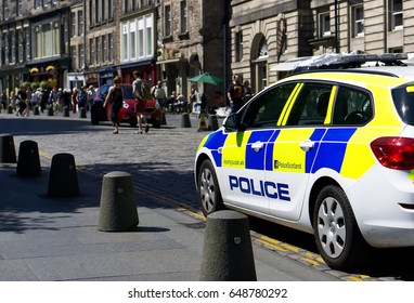 EDINBURGH, SCOTLAND - MAY 26, 2017 : Police Vehicle responds to an emergency on a city center street during special event.