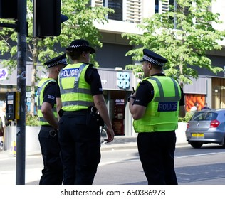 EDINBURGH, SCOTLAND - MAY 26, 2017 : Police officer on duty on a city centre street during special event.