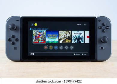 Edinburgh, Scotland - May, 3rd 2019: Nintendo Switch console in Portable Mode with Home Screen displayed