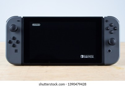 Edinburgh, Scotland - May, 3rd 2019: Nintendo Switch console in Portable Mode with logos displayed on screen - Loading
