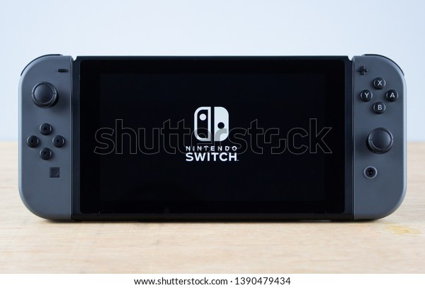Edinburgh, Scotland - May, 3rd 2019: Nintendo Switch console in Portable Mode with logo displayed on screen