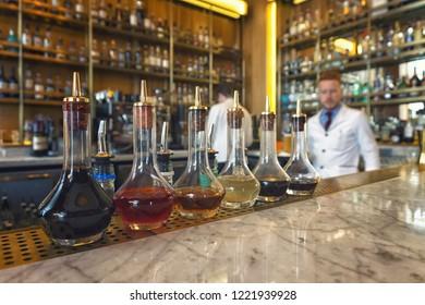 EDINBURGH, SCOTLAND - November 1, 2018: Cocktail flasks at the bar in Edinburgh Grand Hotel.