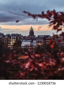 Edinburgh, Scotland - November, 2018. View of the West Register House on the Charlotte Square in the New Town of Edinburgh, on the foreground autumn leaves of a tree. United Kingdom