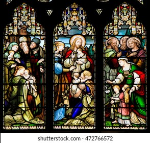 EDINBURGH, SCOTLAND - OCTOBER 02, 2014: Stained glass window illustrated Bible stories in the  St Giles' Cathedral of Edinburgh, Scotland, UK.