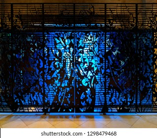 EDINBURGH, SCOTLAND - OCTOBER 15, 2018: Blue glass and intricate metal screen at the entrance to St Giles' Cathedral on the Royal Mile in Edinburgh, Scotland