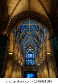 EDINBURGH, SCOTLAND - OCTOBER 15, ‎2018: Breathtaking stained glass windows, ceiling, arches and Gothic architecture in beautifully lit  St Giles' Cathedral on the Royal Mile in Edinburgh, Scotland