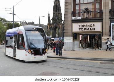 EDINBURGH, SCOTLAND - OCTOBER 22, 2019: A tram passing the corner Princes Street/South St Andrew Street in Edinburgh, Scotland
