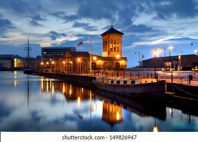 Edinburgh, Scotland, Old Harbour Building Leith with boat at dusk