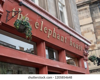 "Edinburgh, Scotland- September 26 2018: some tourists on the Edinburgh road, curiously watching ""The Elephant House"""