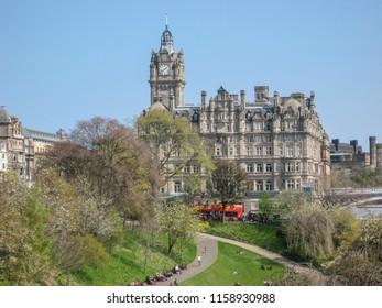 Edinburgh / Scotland / UK - 04/20/2014: View of Edinburgh city center with Princes Street Gardens and a neoclassic building on background