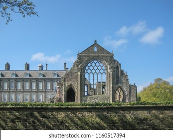Edinburgh / Scotland / UK - 04/20/2014: View of Holyrood Abbey on Holyrood Palace, a ruined Gothic abbey of the Canons Regular, in Edinburgh