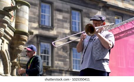 EDINBURGH, SCOTLAND, UK 17 August 2017 .Artist performing on Fringe Festival, Royal Mile Edinburgh. Fringe is the very popular and largest arts festival in the world. Selective focus on stand artist.