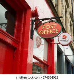 EDINBURGH, SCOTLAND, UK - 2 MAY 2015: Post Office and Moneygram logo signs in the old town area