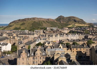 EDINBURGH, SCOTLAND, UK - 7 SEPTEMBER 2015: Old Town buildings in front of Arthurs Seat and Salisbury Crags