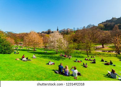 Edinburgh, Scotland, UK - April 18 2014: People relaxing and picnicking on a sunny warm spring day in Princes Street Gardens in Edinburgh, Scotland.