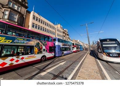 Edinburgh, Scotland, UK - April 18 2014: Public transport, i.e. buses, taxis and trams on Princes Street in Edinburgh.