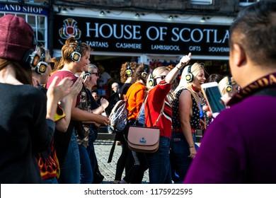 Edinburgh, Scotland / UK - August 2018: Tourists enjoy a silent disco at The Edinburgh Fringe Festival