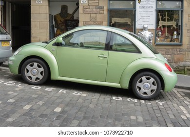 EDINBURGH, SCOTLAND, UK - CIRCA AUGUST 2015: light green Volkswagen New Beetle car parked in a street of the city centre.