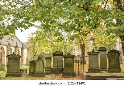 EDINBURGH, Scotland, UK - October  2015: Greyfriars Kirkyard graveyard since the 16th century. Famous historical place and landmark in the city.