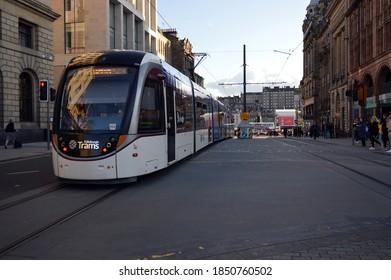 EDINBURGH. SCOTLAND. UNITED KINGDOM. 12-10-19. A tram passes down St. Andrews Street in the city centre.