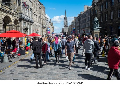 Edinburgh, Scotland, United Kingdom 8.16.18 Tourists enjoy entertainment on the Royal Mile during the annual Fringe Festival