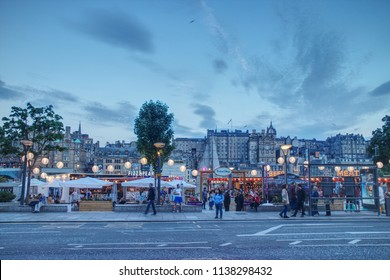 Edinburgh, Scotland / United Kingdom : July 19 2018: People are enjoying street food stands on the Princes Street esplanade in the Edinburgh City Centre set-up for the Edinburgh Festival.