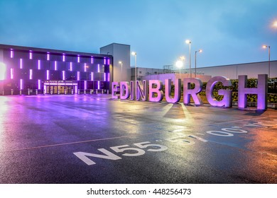 EDINBURGH, SCOTLAND, UNITED KINGDOM - JUNE 14, 2016: Edinburgh airport after rain at twilight. Only the Edinburgh text is in focus due to DOF technique.