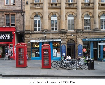 EDINBURGH - SEPTEMBER 2016:  Shops and bicycle rental on the Royal Mile, the main commercial street in Old Town.