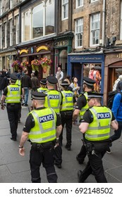 EDINBURGH, UK - 04 AUGUST 2017: A group of police officers partol the Royal Mile during the Festival