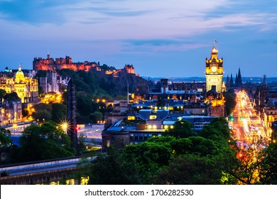 Edinburgh, UK. Aerial view from Calton Hill in Edinburgh, Scotland. The city with illuminated Castle and Clock Tower at night. Cloudy sunset sky
