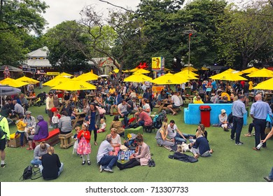 EDINBURGH, UK - AUGUST 12, 2017 : People enjoying themselves having a drink on the grass of the George Square beer gardens during the Edinburgh Fringe Festival.