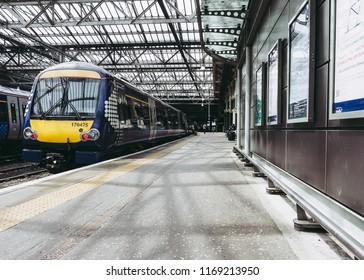 EDINBURGH, UK - CIRCA JUNE 2018: Trains at Edinburgh Waverly railway station