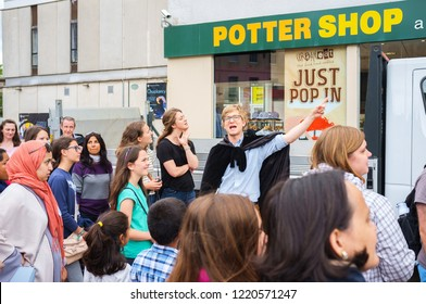 Edinburgh, UK - July 23, 2016: Harry Potter tour guide and people in front of a shop in Edinburgh Scotland