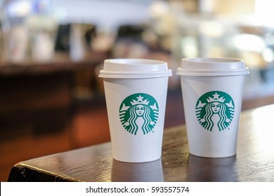 Edinburgh, United Kingdom - 14 February 2017 : Starbucks take away, hot beverage coffee cup with logo, on the table in store. Two cups, Buy one get one free.