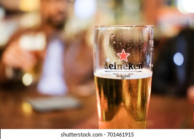 Edinburgh, United Kingdom - 22 August 2017: A Pint Glass of Heineken, Lager Beer produced by the Dutch brewing company. It is well known for its signature green bottle and red star.
