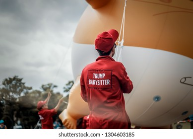 Edinburgh, United Kingdom 23 January 2019. A team of 'Trump babysitters' hold on to the giant balloon of Donald Trump, with thousands of on-lookers.
