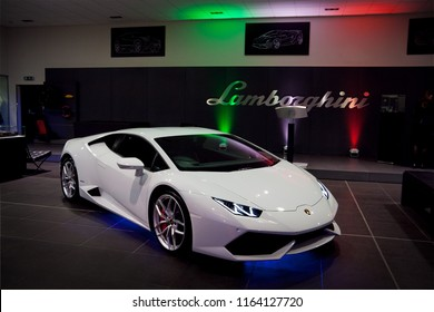 Edinburgh, United Kingdom - 24/07/2014: The Lamborghini Huracan sports car parking in the Lamborghini Edinburgh dealership with lights displaying the Italian flag in the background.