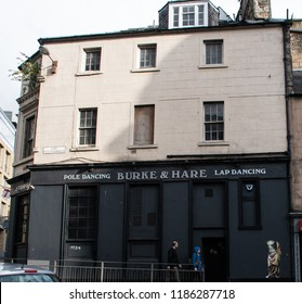 Edinburgh, United Kingdom - August 10 2018:   The amusingly named Burke and Hare lap and Pole dancing bar in East Fountainbridge