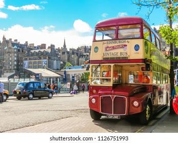 EDINBURGH, UNITED KINGDOM - JUNE 15, 2013: Vintage bus on the street of Edinburgh. Double decker tour bus in the Old Town Edinburgh, Scotland, UK