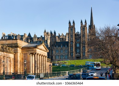 Edinburgh, United Kingdom â?? March 20,  2018 : People walking while busses and cars and taxis are in the street in front of the National gallery with new college in the background in Edinburgh
