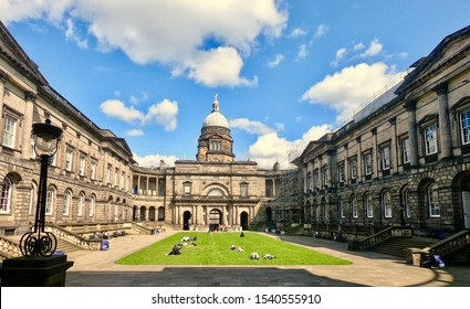 Edinburgh University, famous landmark, The Old College which houses the School of Law and was built in the 18th century. Students lying on grass. south Bridge Edinburgh City Scotland. October 2019