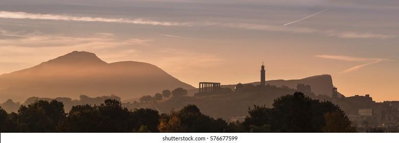 Edinburgh's Calton Hill at sunrise viewed from Inverleith. Scotland, United Kingdom