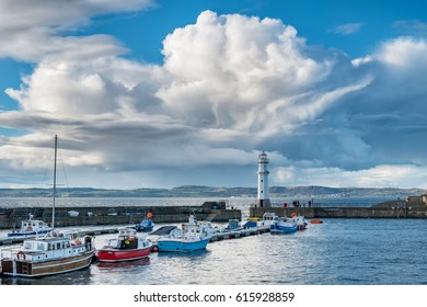 Edinburgh's Newhaven harbour with interesting cloud formations above. Scotland, UK