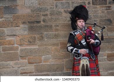 Edinburgh,Scotland  - September 27, 2016 : Scottish man is playing bagpipes in town