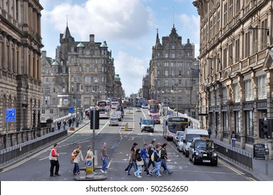 EDINGBURGH, GREAT BRITAIN - JULY 2010: View towards North bridge and the Old Town of Edinburgh with heavy traffic, busses and people crossing the street.